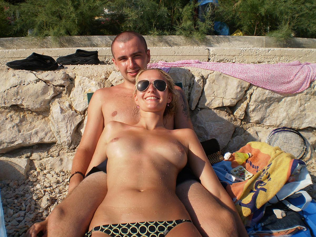 8507995012 e5d237feb3 b Topless Beach Couple