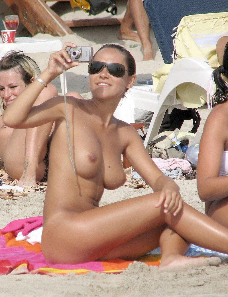 Nude girls having sex on beach